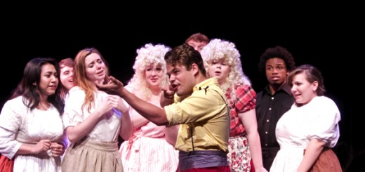 Zachary Pfrimmer as Gaston explaining to his adoring fans the nuances of hunting.