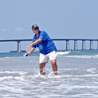 Larry Hansen, ship's carpenter, launching his ship from Oregon Inlet.
