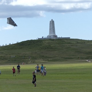 Flying sled kites at the Wright Brothers Memorial, NPS Centennial day.